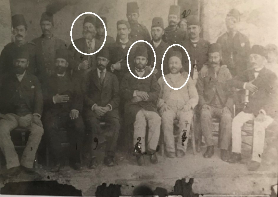 Fig. 1. The Turkish kaϊmakam Ohanes Ferit with Turkish officials and Karpathian mayors in the last years of Turkish rule. On the left is Emmanouel Manolakakis, in the middle is Hassan Effendi and on the right the kaϊmakam Ohanes Ferit, jokingly referred to by Mabel as 'the Cream'. © Emanouel Cassotis.